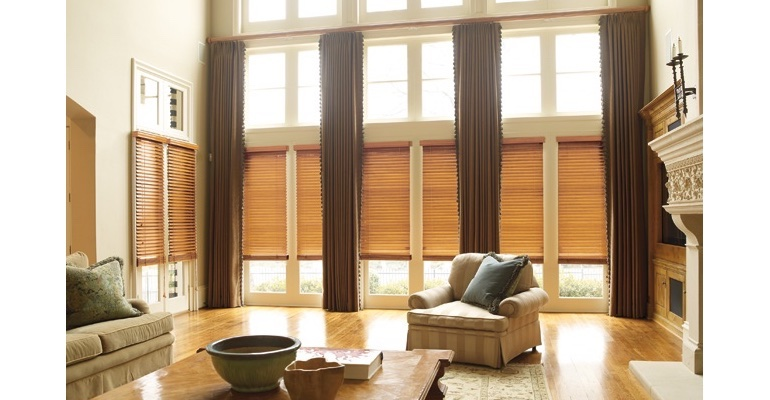 Las Vegas great room with natural wood blinds and floor to ceiling draperies.